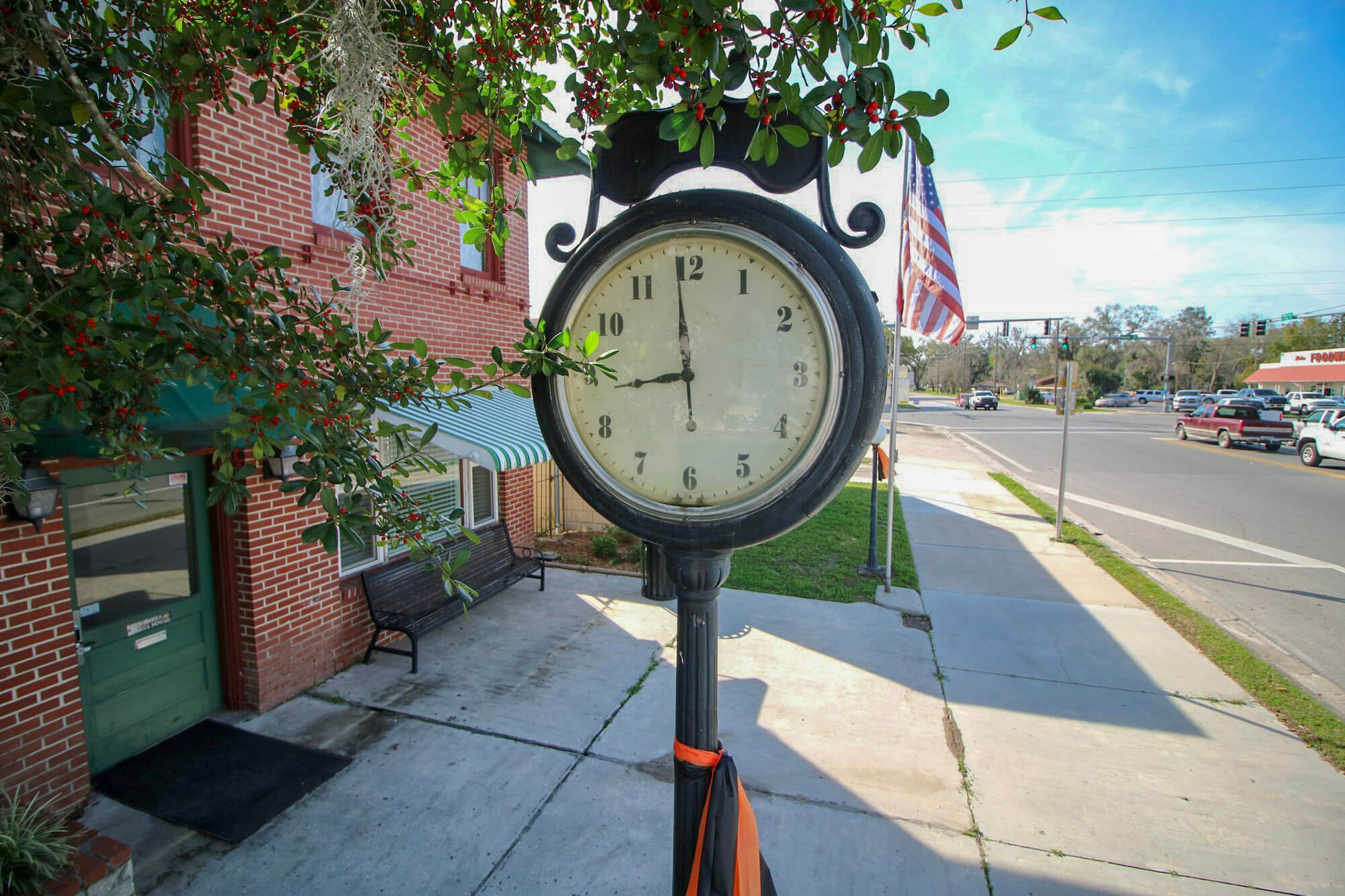 Trenton clock by city hall with street in the background